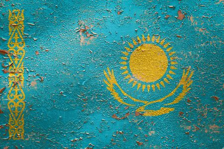 National flag of Kazakhstan  on old peeling wall background.The concept of national pride and symbol of the country. Zdjęcie Seryjne