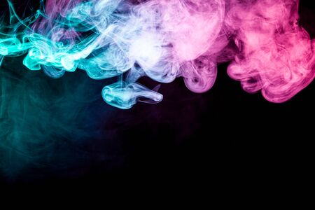 Smoke of pattern pink and blue   on a dark isolated background.  Scary and mysterious symbol