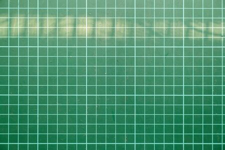 Graph green paper background texture.Technical backdrop paper. Фото со стока