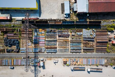 Top view of the industrial zone: railway rails, garages, warehouses, truck,metal. The concept of storage of goods by importers, exporters, wholesalers, transport enterprises, customs 스톡 콘텐츠