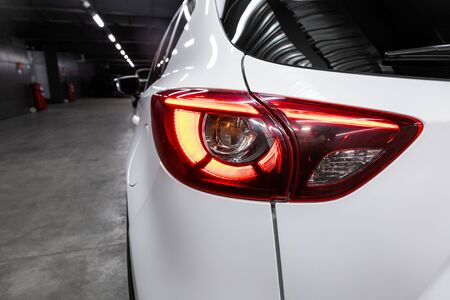 Back view of new white city crossover. Closeup headlights of car  SUV. Modern rear light closeup. Car lamp close-up. Standard-Bild - 130957059
