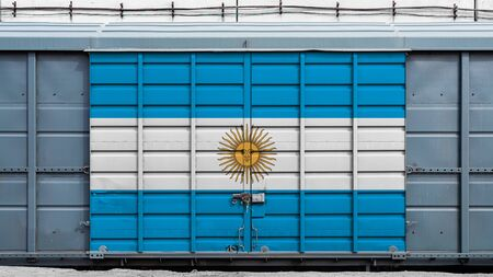 Front view of a container train freight car with a large metal lock with the national flag of Argentina.The concept of export-import,transportation, national delivery of goods and rail transportation Standard-Bild - 130957082