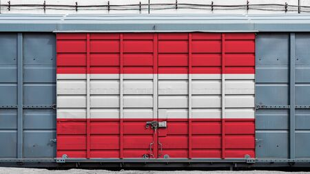 Front view of a container train freight car with a large metal lock with the national flag of Austria.The concept of export-import,transportation, national delivery of goods and rail transportation Standard-Bild - 130957094