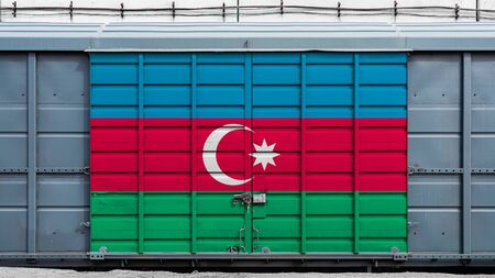 Front view of a container train freight car with a large metal lock with the national flag of Azerbaijan.The concept of export-import,transportation, national delivery of goods and rail transportation Stockfoto