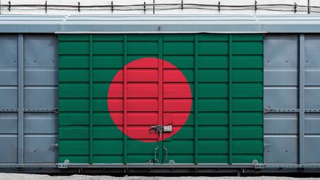 Front view of a container train freight car with a large metal lock with the national flag of Bangladesh.The concept of export-import,transportation, national delivery of goods and rail transportation Standard-Bild - 130957098