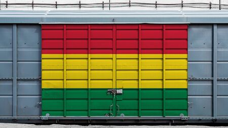 Front view of a container train freight car with a large metal lock with the national flag of Bolivia.The concept of export-import,transportation, national delivery of goods and rail transportation