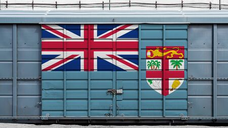 Front view of a container train freight car with a large metal lock with the national flag of Fiji.The concept of export-import,transportation, national delivery of goods and rail transportation Фото со стока