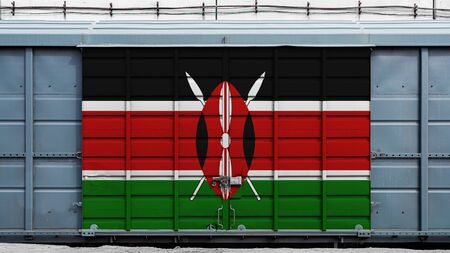 Front view of a container train freight car with a large metal lock with the national flag of Kenya.The concept of export-import,transportation, national delivery of goods and rail transportation