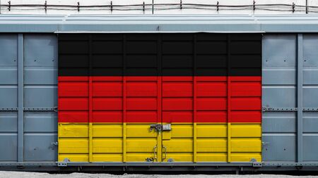 Front view of a container train freight car with a large metal lock with the national flag of Germany.The concept of export-import,transportation, national delivery of goods and rail transportation