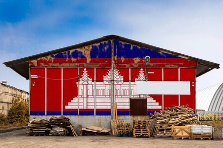 Close-up of the national flag of Cambodia  painted on the metal wall of a large warehouse the closed territory on a summer day. The concept of storage of goods, entry to a closed area, tourism Stock fotó