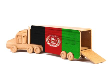 Close-up of a wooden toy truck with a painted national flag Afghanistan. The concept of export-import,transportation, national delivery of goods