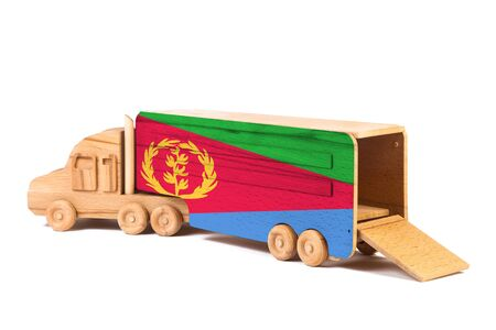 Close-up of a wooden toy truck with a painted national flag Eritrea. The concept of export-import,transportation, national delivery of goods