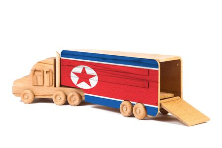 Close-up of a wooden toy truck with a painted national flag North Korea. The concept of export-import,transportation, national delivery of goods Stock Photo - 133297570