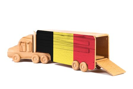 Close-up of a wooden toy truck with a painted national flag Belgium. The concept of export-import,transportation, national delivery of goods