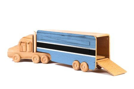 Close-up of a wooden toy truck with a painted national flag Botswana. The concept of export-import,transportation, national delivery of goods