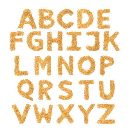 English alphabet from from yellow dry corn  on a white isolated background. Food pattern made from corn. bright alphabet for shops. cereal for corn porridge
