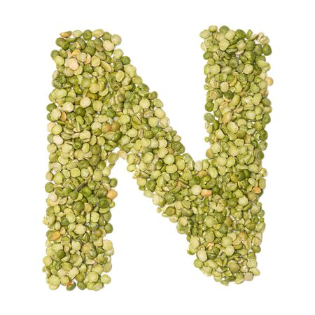 Letter N of the English alphabet from freshly green chopped peas  on a white isolated background. Food pattern made from peas. bright alphabet for shops. pea cereal