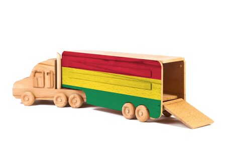 Close-up of a wooden toy truck with a painted national flag Bolivia. The concept of export-import,transportation, national delivery of goods