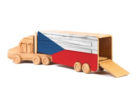 Close-up of a wooden toy truck with a painted national flag Czech. The concept of export-import,transportation, national delivery of goods