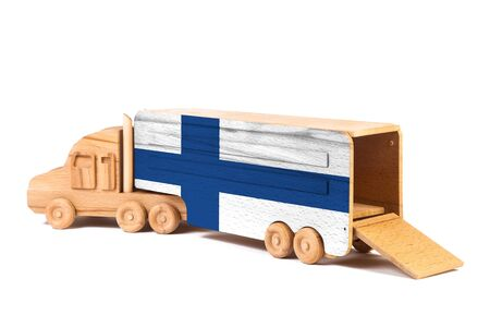 Close-up of a wooden toy truck with a painted national flag Finland. The concept of export-import,transportation, national delivery of goods