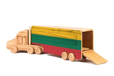 Close-up of a wooden toy truck with a painted national flag Lithuania. The concept of export-import,transportation, national delivery of goods Stock Photo