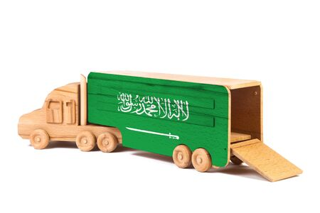 Close-up of a wooden toy truck with a painted national flag Saudi Arabia. The concept of export-import,transportation, national delivery of goods Stok Fotoğraf