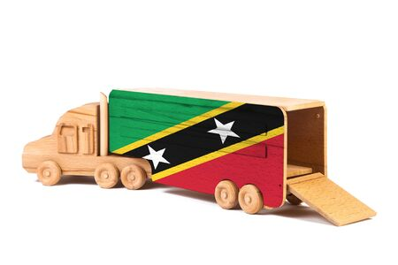 Close-up of a wooden toy truck with a painted national flag Saint Kitts and Nevis. The concept of export-import,transportation, national delivery of goods