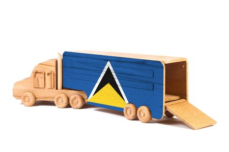 Close-up of a wooden toy truck with a painted national flag Saint Lucia . The concept of export-import,transportation, national delivery of goods