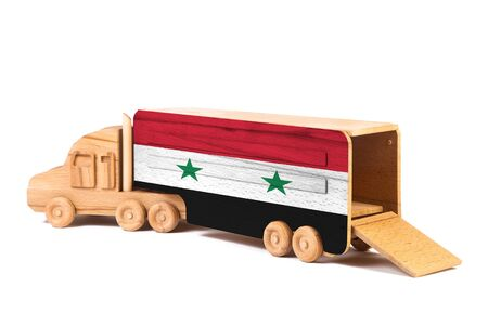 Close-up of a wooden toy truck with a painted national flag Syria. The concept of export-import,transportation, national delivery of goods