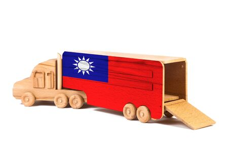 Close-up of a wooden toy truck with a painted national flag Taiwan. The concept of export-import,transportation, national delivery of goods