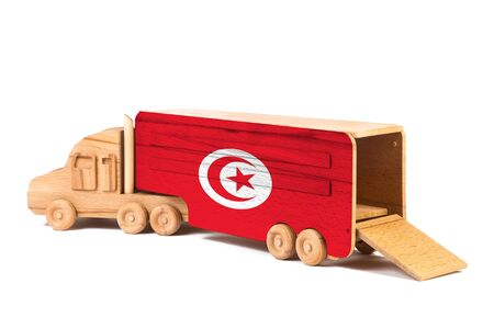 Close-up of a wooden toy truck with a painted national flag Tunisia. The concept of export-import,transportation, national delivery of goods