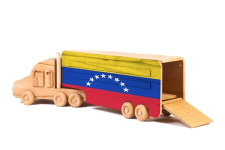 Close-up of a wooden toy truck with a painted national flag Venezuela. The concept of export-import,transportation, national delivery of goods