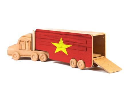 Close-up of a wooden toy truck with a painted national flag Vietnam. The concept of export-import,transportation, national delivery of goods Stok Fotoğraf