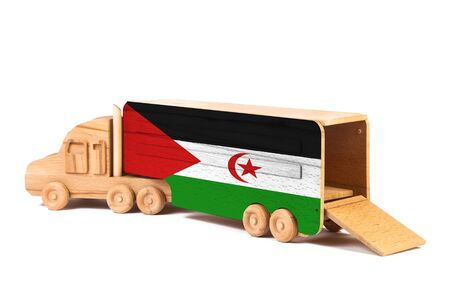 Close-up of a wooden toy truck with a painted national flag West Sahara. The concept of export-import,transportation, national delivery of goods Stock fotó