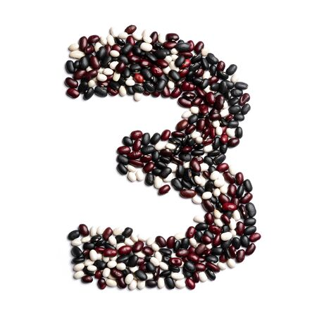 Arabic numeral 3 from colorful beans on a white isolated background. Purple, White, Brown Beans pattern. healthy food concept. Letters for composing texts Stok Fotoğraf