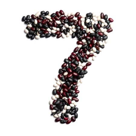 Arabic numeral 7 from colorful beans on a white isolated background. Purple, White, Brown Beans pattern. healthy food concept. Letters for composing texts