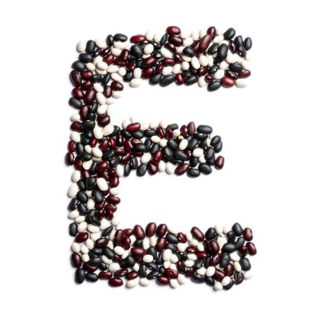 The letter E of the English alphabet from colorful beans on a white isolated background. Purple, White, Brown Beans pattern. healthy food concept. Letters for composing texts