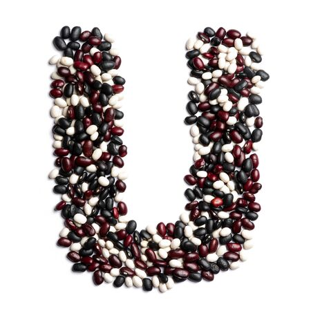 The letter U of the English alphabet from colorful beans on a white isolated background. Purple, White, Brown Beans pattern. healthy food concept. Letters for composing texts
