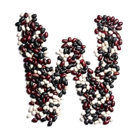 The letter W of the English alphabet from colorful beans on a white isolated background. Purple, White, Brown Beans pattern. healthy food concept. Letters for composing texts