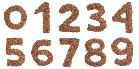 Arabic numerals   from  brown dry buckwheat on a white isolated background. Food pattern made from groats. bright  numeral for design.  Buckwheat for porridge