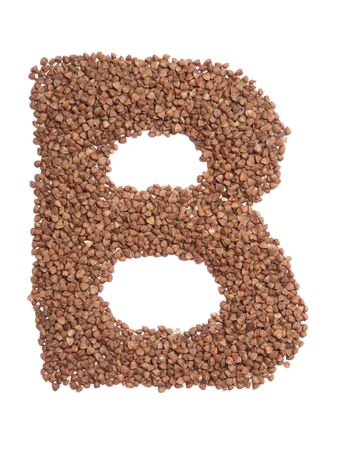 Letter B of the English alphabet from  brown dry buckwheat  on a white isolated background. Food pattern made from groats. Bright alphabet for shops.  Buckwheat for porridge 写真素材