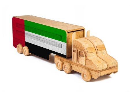 Close-up of a wooden toy truck with a painted national flag United Arab Emirates. The concept of export-import,transportation, national delivery of goods