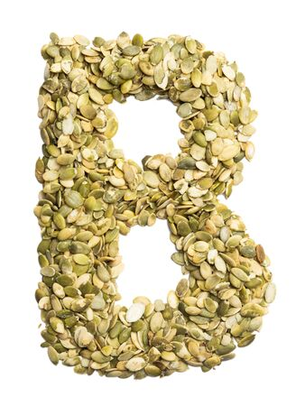 Letter B of the English alphabet from pumpkin seeds on a white isolated background. Food pattern made from seeds. Bright alphabet for shops.