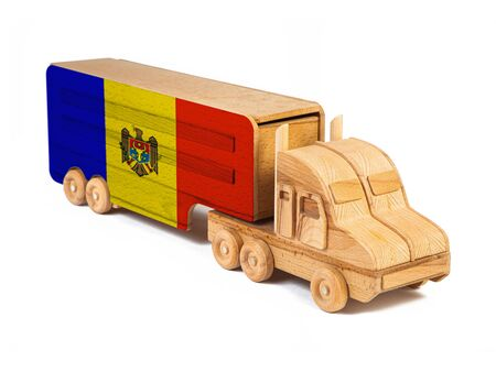 Close-up of a wooden toy truck with a painted national flag Moldova. The concept of export-import,transportation, national delivery of goods