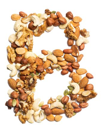Letter B of the English alphabet from a mixture of hazelnuts, almonds, walnuts, peanuts, cashews, pumpkin seeds on a white isolated background. Food pattern made from nuts. Bright alphabet for shops.