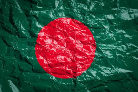 National flag of Bangladesh on crumpled paper. Flag printed on a sheet. Flag image for design on flyers, advertising.