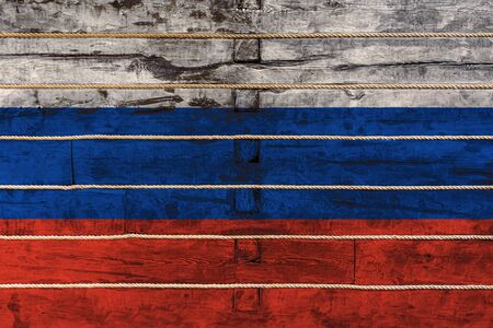 National flag  of Russia on a wooden wall background. The concept of national pride and a symbol of the country.