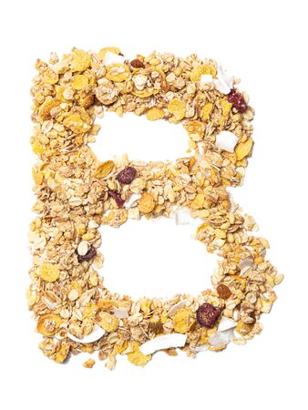 Letter B of the English alphabet muesli with coconut, berries, raisins, cereal and natural cereals on a white isolated background. Food pattern made from granola. bright alphabet for shops.