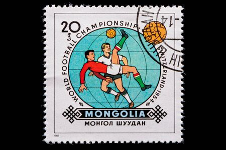 Novosibirsk, Russia - January 07, 2020: stamp printed in  Mongolia shows how football players play football, a postage stamp in honor of the 1954 WORLD FOOTBALL CHAMPIONSHIP in SWITZERLAND