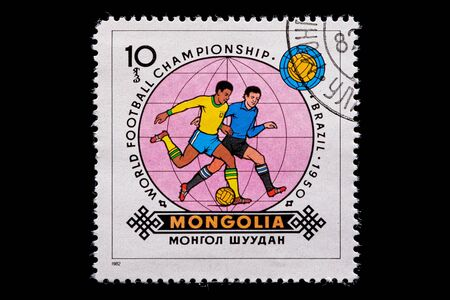 Novosibirsk, Russia - January 07, 2020: stamp printed in  Mongolia shows how football players play football, a postage stamp in honor of the 1950 WORLD FOOTBALL CHAMPIONSHIP in Brazil